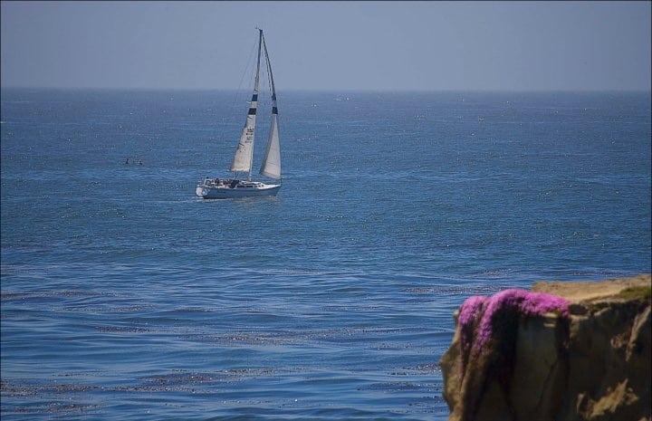 sailing sailboat boating ocean cliff seaside