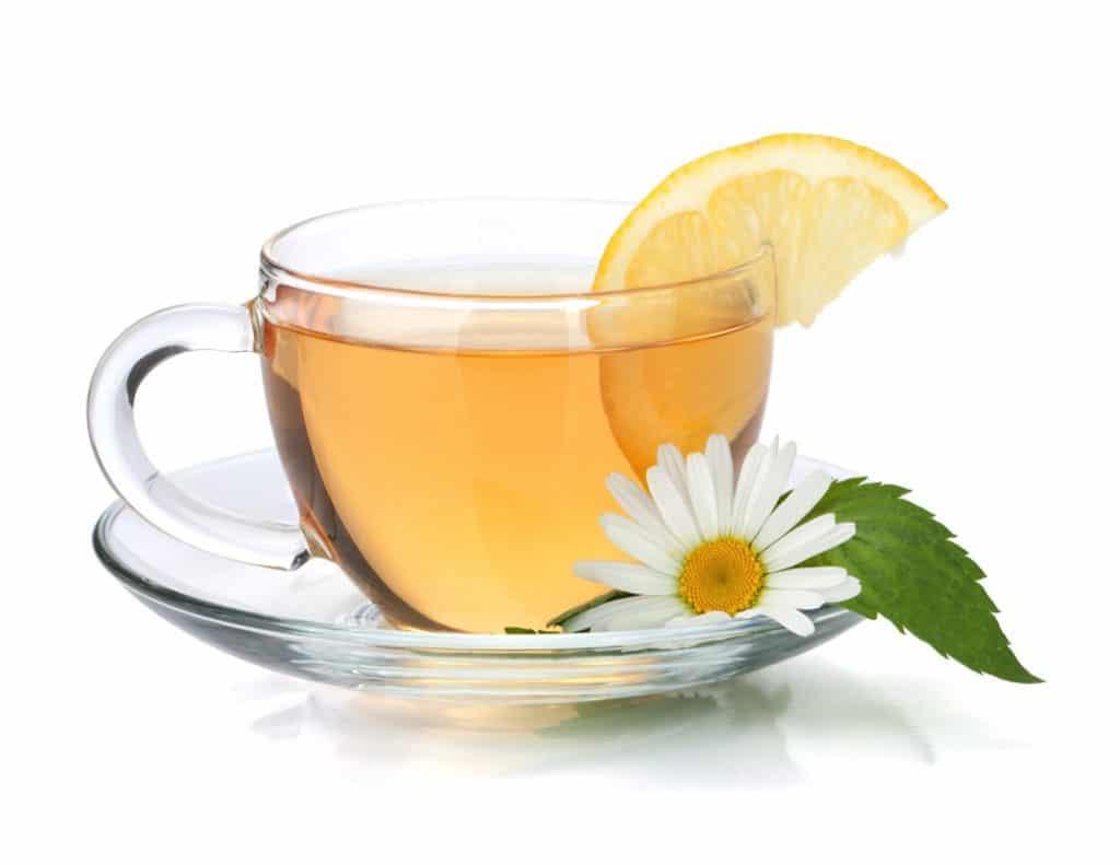 glass teacup saucer herbal tea lemon daisy