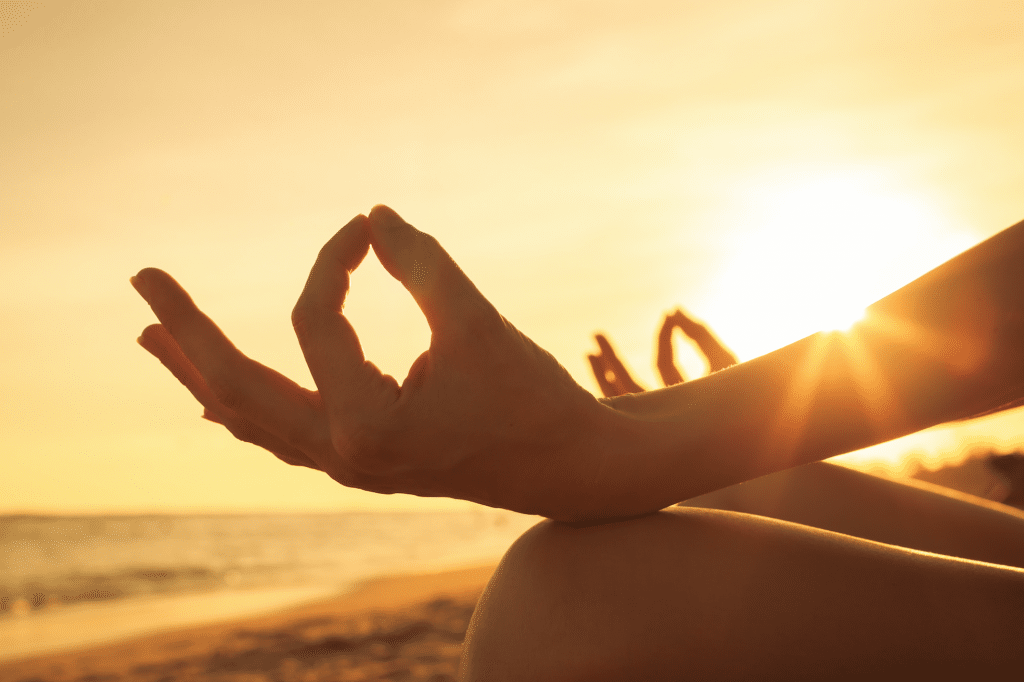 daily meditation woman meditation sunset sunrise beach