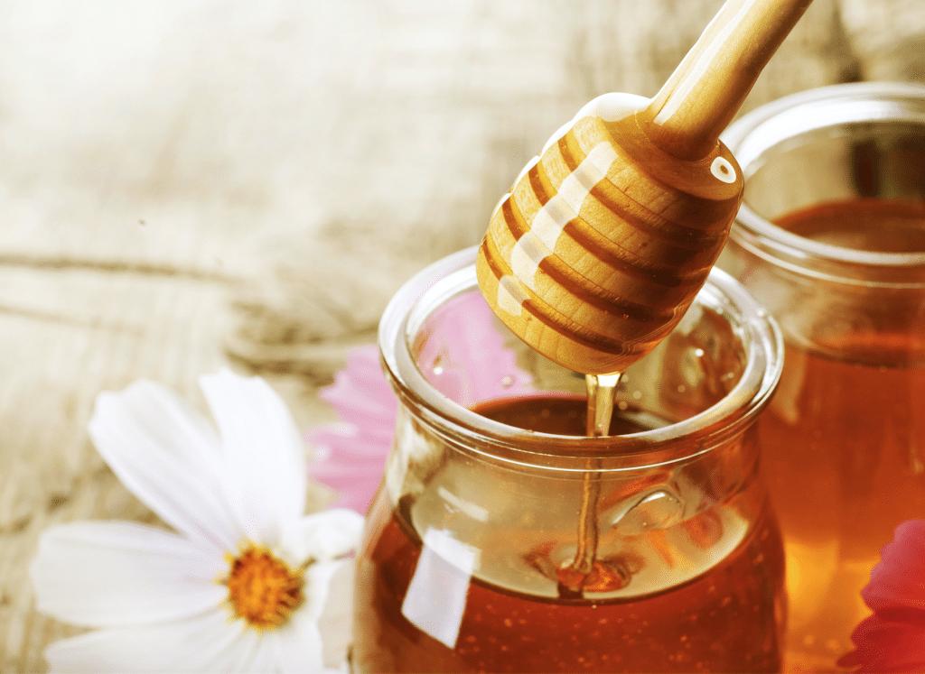 honey extracted glass jar wood spoon dipper
